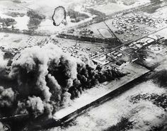 Wheeler Field under attack, December 7, 1941 :: This photo by a Japanese pilot shows Wheeler aircraft and other facilities in flames. During attack 37 men at Wheeler lost their lives, six were reported missing and 53 were wounded, December 7, 1941.