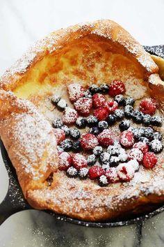 Dutch Baby Pancake with fresh berries and powdered sugar.