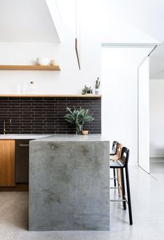 """Concrete Waterfall End. """"Working with our architect was wonderful. She was able to offer imaginative solutions and we got so much more out of the build than we ever thought we could,"""" says Olwen, homeowner. *Images courtesy of [Hancock Architects]"""