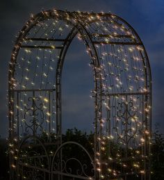 wrought-iron arbors and benches look magical & mystical at night, covered in solar LED lights....absolutely dreamy!