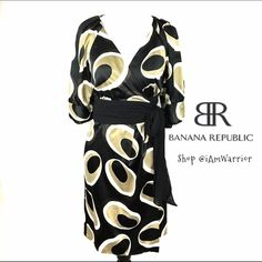 Banana Republic satin printed wrap dress Flattering black silky matte satin black dress with modern abstract oval taupe and white print. Has wide gathered chiffon waist that tie/wraps around. Pretty pleated shoulder and 3/4 sleeve with satin button details. Lovely v-neck and midi length. Satin has a few minor snags on the sleeves but barely noticeable with the printed fabric. Otherwise in great condition. If this is your first time shopping my closet, please read my closet policies (about me…