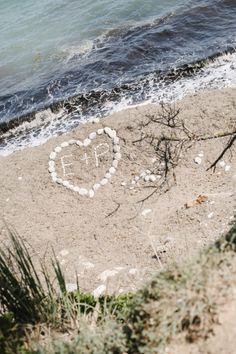 Initials in the sand.