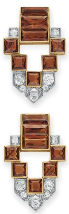 *A PAIR OF ART DECO DIAMOND AND CITRINE CLIP BROOCHES, BY CARTIER Each designed as a rectangular-cut citrine and old European-cut diamond openwork clip of geometric motif, mounted in platinum and gold, circa 1935, in a Cartier red leather case Each signed Cartier