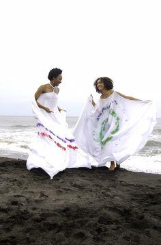 Resort Caftans on a Black Sand Beach - Designer - Kimya Glasgow;     Photographer - Maxin Browne;  Models: Malaika Glasgow & Allison DaSilva; Location - Byera Beach, St Vincent and the Grenadines