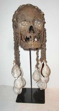 ASMAT-HEAD-HUNTER-ANCESTRAL-HUMAN-TROPHY-SKULL-WITH-SHELL-HEADDRESS-ON-STAND