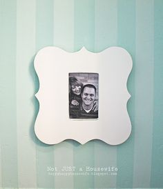 I think I could even make these. Wood cut outs, paint, mod pog and some pictures. I even have the perfect place for a display of them!