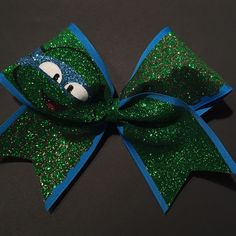 3in. Glitter TMNT Cheer Bow ($15) ❤ liked on Polyvore featuring accessories, hair accessories, bow headband, bow headwrap, head wrap headband, glitter elastic headbands and hair bands accessories