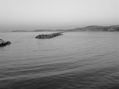 Sea, rocks and... b/w image