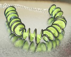 Green Spiral Necklace - Lampwork Jewelry - Lampwork Necklace - Glass Bead Jewelry - Glass Bead Necklace - Elegant Jewelry - Wife Gift  This necklace features a 5 Lampwork spiral beads, the bead size is 30-35mm. The beads are very unique   The 925 sterling silver necklace length is 50cm and 5cm extention.  This necklace makes a bold statement that will upgrade each performance.  All of my jewelry comes with a gift box.  $45