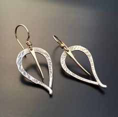 A sweet pair of earrings solo or as an accompaniment to the Ginkgo Fern Pendant. Hand forged from 24 gauge argentium sterling sheet, the gentle slo...