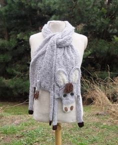 Very long gray donkey shawl animal scarf knit knitted scarf winter accessory for animal lovers soft burro neck warmer winter gift   Very nice, soft acrylic donkey scarf made of gray-white yarn, with button eyes, textile nostrils and brown yarn mane and tail.  Length with legs (without stretching): ca 79 (200 cm) Body width (without stretching): 8.7 (22 cm)   Made in a smoke-free house.  Ready to ship.   Please check dimensions carefully. Due to lighting conditions and monitor settings…