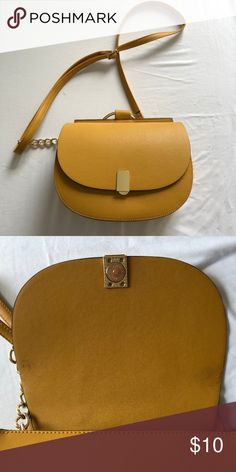 a0d0dfac0ec Bold Mustard Crossbody Mustard crossbody with quarter chain strap. One  zipper pocket. • Great