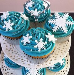 Vanilla cupcake with blue frosting and snowflakes on the top good for winter parties
