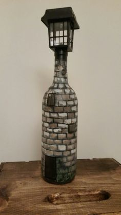 Hand painted wine bottle with solar light. All by me Victoria Holt!