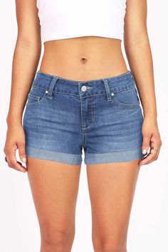 """Low rise shorts in a light denim wash with rolled up cuffed hem. Traditional 5-pockets and button zip fly closure. *Machine Wash Cold *51% Cotton 31% Rayon 17% Polyester 1% Spandex *9.5""""/24 cm Top to"""