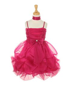Featuring plenty of pouf from its luxurious pick-up hem and a rhinestone-centered bow, this gown is perfect for dressy occasions. The back tie, strip of elastic and zipper create the kind of fit that will have any little lady feeling like a petite princess.