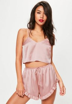 Get a sassy look with this pink satin pyjama set - and be queen of the night . be0624763