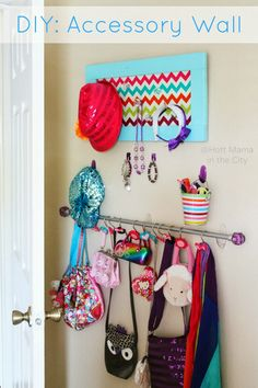 DIY: Accessory Wall. Use the empty space behind the door, a few hooks, curtain rod and shower hooks to create an accessory wall.