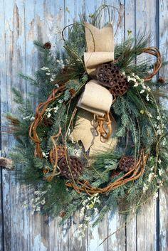 Winter Wreath, Mixed Pine, Lotus Pods, Burlap Bow via Etsy.