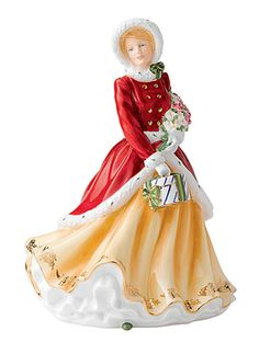 This lovely 2012 Royal Doulton lady is hand-rendered in beautifully-painted fine bone china and represents a bountiful bouquet of winter blooms and traditional Christmas gift.
