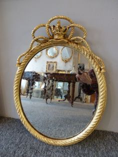 A pair of gilt victorian wall mirrors with rope and crown decoration