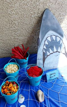 "Easy shark birthday party ideas. Love this ""shark bait"" snack table setup."