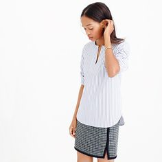 """We married a tailored crisp shirt with a laid-back tunic for a wear-almost-anywhere result—one that gives Friday afternoon at the office and Saturday-morning errands some common ground. <ul><li>Body length: 27"""".</li><li>Cotton.</li><li>Long roll-up sleeves.</li><li>Machine wash.</li><li>Import.</li></ul>"""