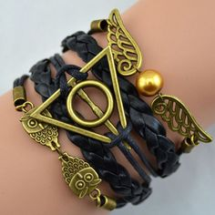 Harry Potter Antique Bronze magic hallows bracelet with owl wings. Harry Potter Armband, Bijoux Harry Potter, Harry Potter Schmuck, Objet Harry Potter, Harry Potter Bracelet, Harry Potter Owl, Harry Potter Deathly Hallows, Harry Potter Fandom, Harry Potter Magie