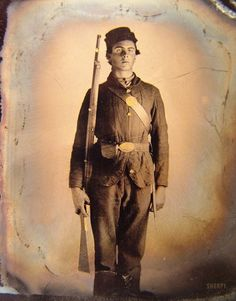 """1861-65. """"Soldier in Union uniform and cap box standing with musket and bayonet with scabbard."""" Sixth-plate tintype, hand-colored, removed from frame. Liljenquist Collection of Civil War Photographs, Library of Congress."""