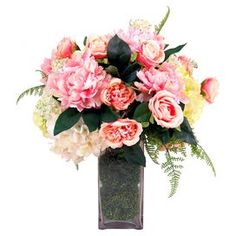 """Add organic-chic appeal to your entryway or dining room with this eye-catching faux peony and hydrangea arrangement, nestled in a square glass vase with moss accents.  Product: Faux floral arrangement Construction Material: Silk, polyester and glassColor: Pink, white and greenFeatures: HandmadeIncludes faux peonies and hydrangeasDimensions: 19"""" H x 17"""" W x 18"""" DCleaning and Care: For indoor use only"""