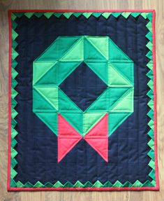 Christmas Wreath Quilt — Crafty Staci Christmas Projects, Christmas Fun, Christmas Wreaths, Christmas Decorations, Holiday, Christmas Present Quilt, Prairie Points, Half Square Triangles, Quilted Wall Hangings