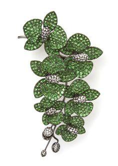 An 18 Karat Gold, Tsavorite and Diamond Orchid Brooch,   Michael Youssouffian,