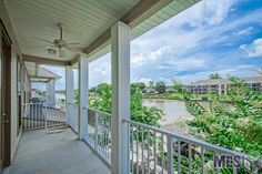This well appointed 3 Bedroom 2.5 Bath Townhome situated on the Amite River Diversion Canal provides spectacular waterfront views. The kitchen features granite counter tops and all stainless appliances. The Master Bedroom is extremely cozy and includes a wet bar, large walk-in closet and en-suite. Have your morning coffee or afternoon cocktails while enjoying the views from your balcony or screened in porch. A deck and covered boat slip with heavy-duty boat lift make this weekend get-a-way…
