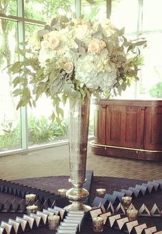 Tall centerpieces/altar arrangements inspiration, but we will add pops of bright pink bougainvillea.