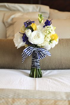 Nautical Theme - (Different flowers for Jen). Coral and white stripes would look more casual than solid satin ribbon.  :  wedding Nautical Bouquet