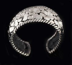 Lydia Lerner  Floral Wide Cuff  Made in Bali  Sterling Silver hand made  2 1/4″ East to West diameter  Detailed sterling silver floral pattern  measures approx 1 1/2″ wide tapering to 1 1/4″ wide at the ends  Substantial piece at 88 grams  Hallmarked LydiaLerner 925