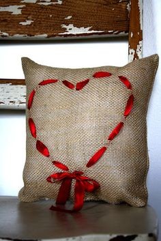 Ok - I think this is what I want for the ring bearer pillow. Love the burlap and the ribbon heart.