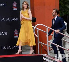 Actors Emma Stone (L) and Ryan Gosling arrive for a hand and footprint ceremony immortalizing them in the forecourt of TCL Chinese Theatre…