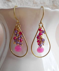Vibrant, feminine and with a playful color scheme combining raspberry pink with purple, Fiona is the pair of earrings to accent all your favorite outfits. I hand formed and lightly hammered a teardrop shape frame out of gold filled wire. Hanging in the center of the frame is a