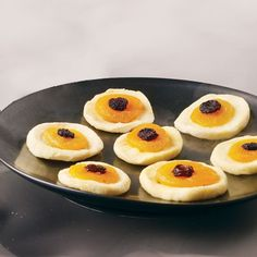 Eerie Eyeballs | from Spoonful | Made with apple rings, apricots, and raisins, these eyeballs are spookily delicious, and so easy! A great, healthy Halloween snack!