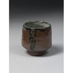 Tea bowl   Place of origin: Mashiko, Japan (made), about 1935-1950 (made)   Artist/Maker: Hamada, Shoji, born 1894 - died 1978 (maker)   Stoneware with rust brown and mottled bluish glazes   V&A Search the Collections