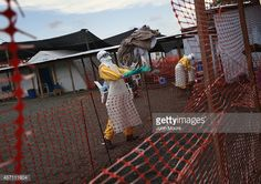 News Photo : A health worker catches a set up clean bedsheets...