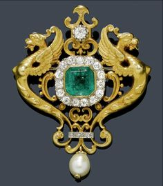 Emerald, diamond and gold brooch, circa 1900. This fabulous on so many levels! Love the intricate dragons..