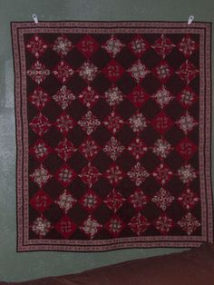 Quilted wall hanging or large lap quilt. Machine pieced and quilted in beautiful browns & reds. $175.00, via Etsy.