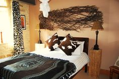 african bedroom themed bed wall art above bed twigs bed hotel luxury