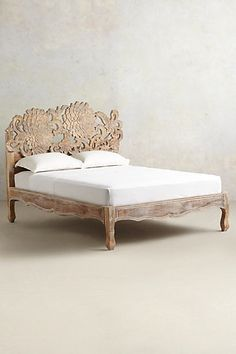 I would love to have this addition to my bedroom. Handcarved Lotus Bed #anthropologie