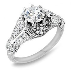 $2,699.99 USD, 1.35 ct. tw. Diamond Engagement Ring. Unique Ladies Diamond Engagement Ring. You may choose to customize the center stone between 0.50-1.00ct round brilliant cut diamond. Surrounded by 0.60ct round cut side diamonds in a prong and channel setting. Handcrafted in 14k Gold, 18k Gold, or Platinum 950 setting. **Free Shipping **1 year layaway