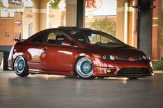 8th Generation Honda Civic. Not a fan of the red, but I love the wheels.  #Honda #HondaCivic #HondaCars