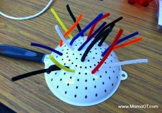 All you need is a colander and some pipe cleaners for some toddler fine motor fun!