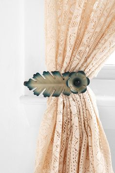 love the idea of holding back the curtains with a feather:)
